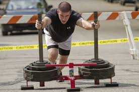 prowler press the site of photo matthew andre pushes the prowler sled with 340