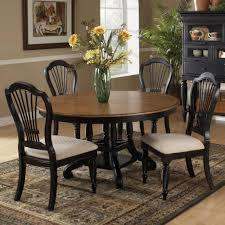 round dining room tables for 6 wilshire wood round oval dining table in pine rubbed black