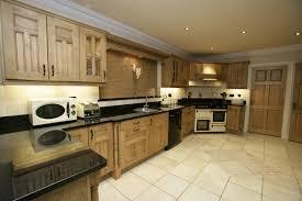 wooden traditional kitchen with dark brown wooden wall cabinets simple traditional kitchen design with brown wooden drawers and wall cabinets also black granite countertop also