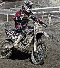 motocross race track person riding on motorcycle on motocross race track wearing white
