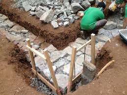 How To Build A Stone by Building A Stone Foundation This Cob House