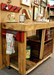 salvaged wood kitchen island beyond the picket fence reclaimed wood island
