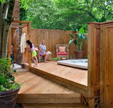 tub deck with a privacy fence and outdoor shower by archadeck
