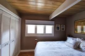 window bedroom design with wood ceilings and bedding also 3 day