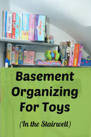 basement organizing for toys in the stairwell heartworkorg com