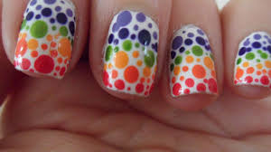 assortment of photos in which multi color nail art is shown for