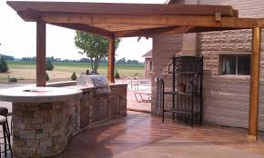 chic color wooden outdoor kitchen pergola featuring stone