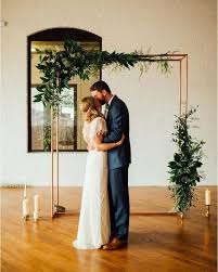 wedding arches coast picture of a copper wedding arch with lush greenery and candles