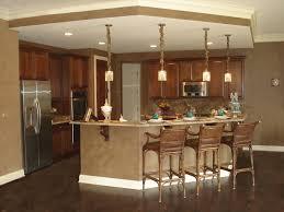 open floor plan kitchen ideas brown wooden kitchen cabinet and four pendant ls