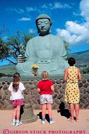 spiritual statues released at buddha statue at jodo mission hawaii stock
