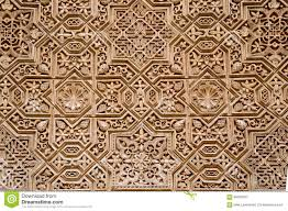 wall detail with arab ornament in alhambra granada spain stock