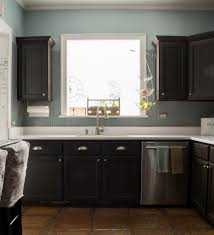 how to paint kitchen cabinets brown how to paint builder grade cabinets