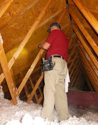 inspecting added blown insulation in an existing vented attic