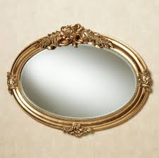 decorating metallic shiny circle decorative wall mirrors in oval decorating mesmerizing oval decorative wall mirrors in gold color with crest top round mirror