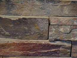paint brick fireplace to look like stone painting concrete patio