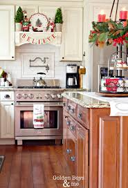 golden boys and christmas the kitchen white kitchen with dark wood island and diy mantel hood decorated holiday decor www