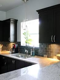 Black Kitchen Cabinets by Moon White Granite Dark Kitchen Cabinets Kitchen Ideas