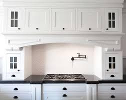 white shaker cabinets with restoration hardware dakota pulls and