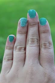 green glitter accent nail white lights on wednesday