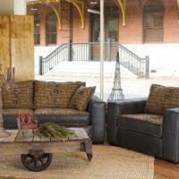living room black leather round big deep sofa with grey