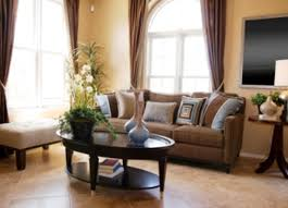 Beige And Green Curtains Decorating Mocha Fabric Sofa And Brown Wooden Table On Beige Tile Floor