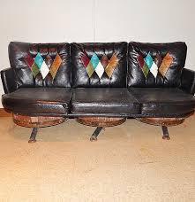 Whiskey Barrel Chairs Vintage Leather Look Whiskey Barrel Sofa Ebth