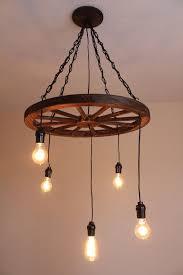 vintage wagon wheel chandelier by uevrwndry on more