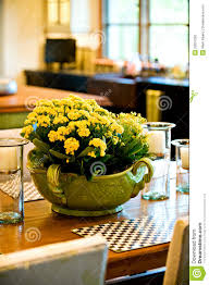 fresh flower arrangement on the dining room table royalty free