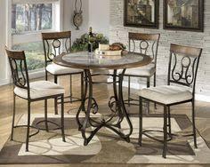 ortanique 5 piece glass top table set by ashley millennium