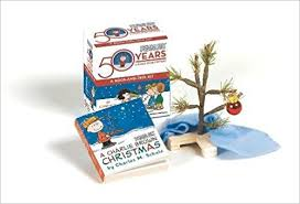 a brown kit book and tree kit miniature