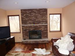 stunning fireplace refacing on interior with ledger stone tile