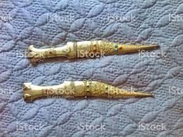 antique pair of gold ornamental daggers stock photo istock