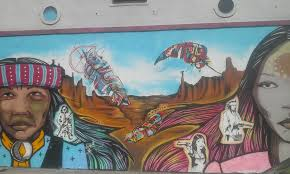 11 east la murals that deserve more than a drive by the siren angels and apaches is part of a stretch of amazing murals on the adjacent wall of the self help graphics building these native american faces staring you
