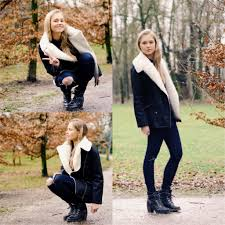 women s black and white shearling jacket navy ripped skinny jeans