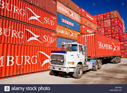semi trailer truck a semi trailer truck hauls a container from a port container stock