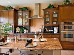 above kitchen cabinets ideas ideas for decorating above kitchen cabinets lovetoknow