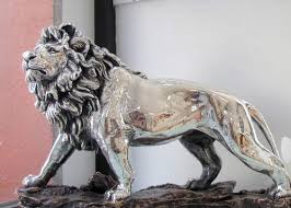 silver lion statue mountain press presents digestworld issue 122 for february 2012