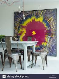 kitchen modern art tolix steel chairs around wooden farmhouse table in modern kitchen
