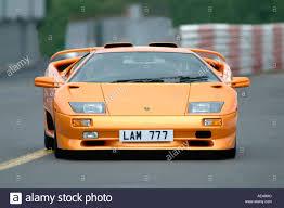 lamborghini murcielago racing orange lamborghini murcielago sports car racing on a race