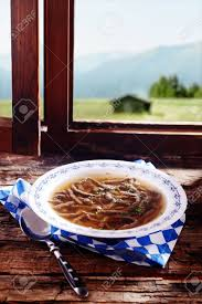 cuisine a et z speciality liver spaetzle in broth served in a bavarian restaurant