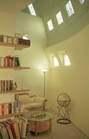 449 best hp dome homes images on pinterest dome homes dome cloud hidden dome home library the high ceiling has glass blocks that provide light for this u shaped library with a secluded reading area