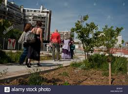families visiting green roof community garden on