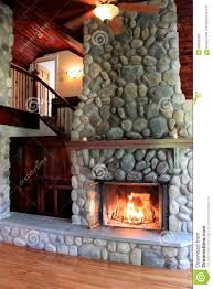 warm scene in lit stone fireplace showcasing craftsmanship in