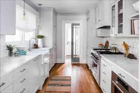cabinet lighting galley kitchen light gray galley style kitchen with farmhouse sink