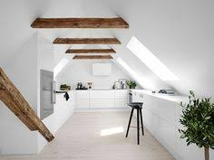 cuisine mansard kitchen design ideas with white cabinets and black dining chairs