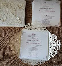graceful ivory shimmery laser cut wedding invitations ewws023 as
