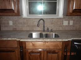 kitchens stacked stone backsplash with white cabinets and