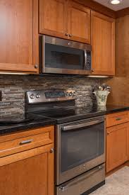 what backsplash looks with cherry cabinets black granite kitchen countertops design ideas countertopsnews