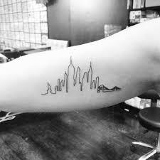 new york skyline tattoo on the right inner arm tattoo artist jon