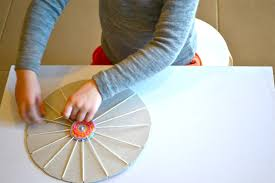 circular weaving using a cardboard frame how we montessori